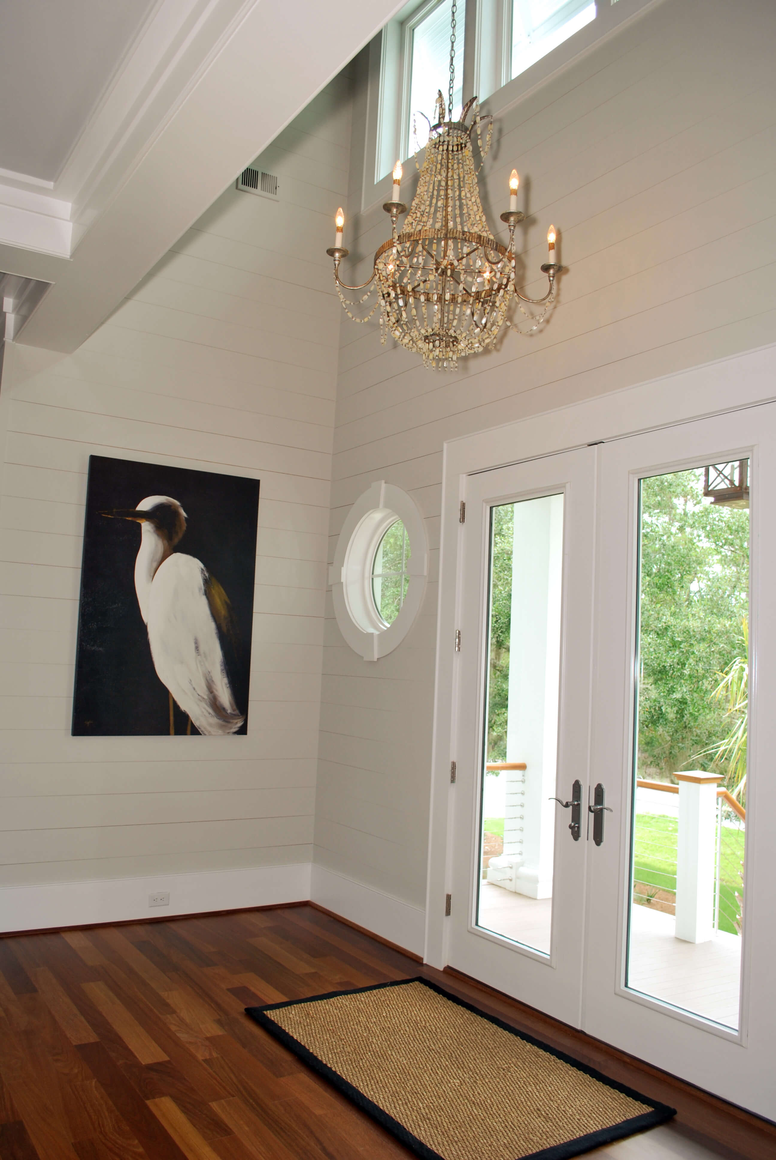 Close view of front entryway, with port hole windows contributing to nautical theme.