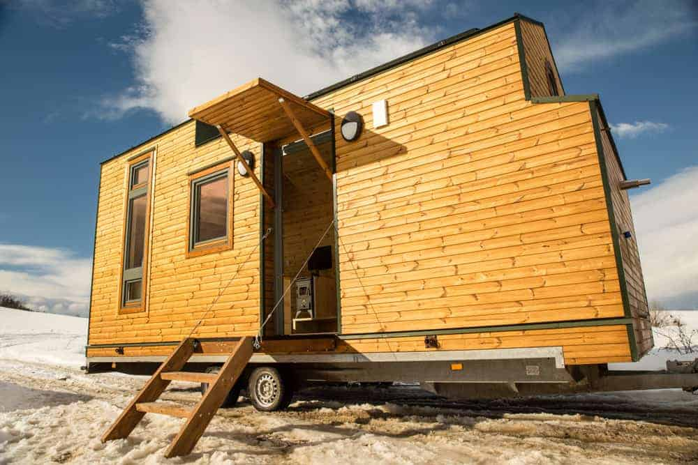 Contemporary tiny house on wheels with beautiful wood exterior.