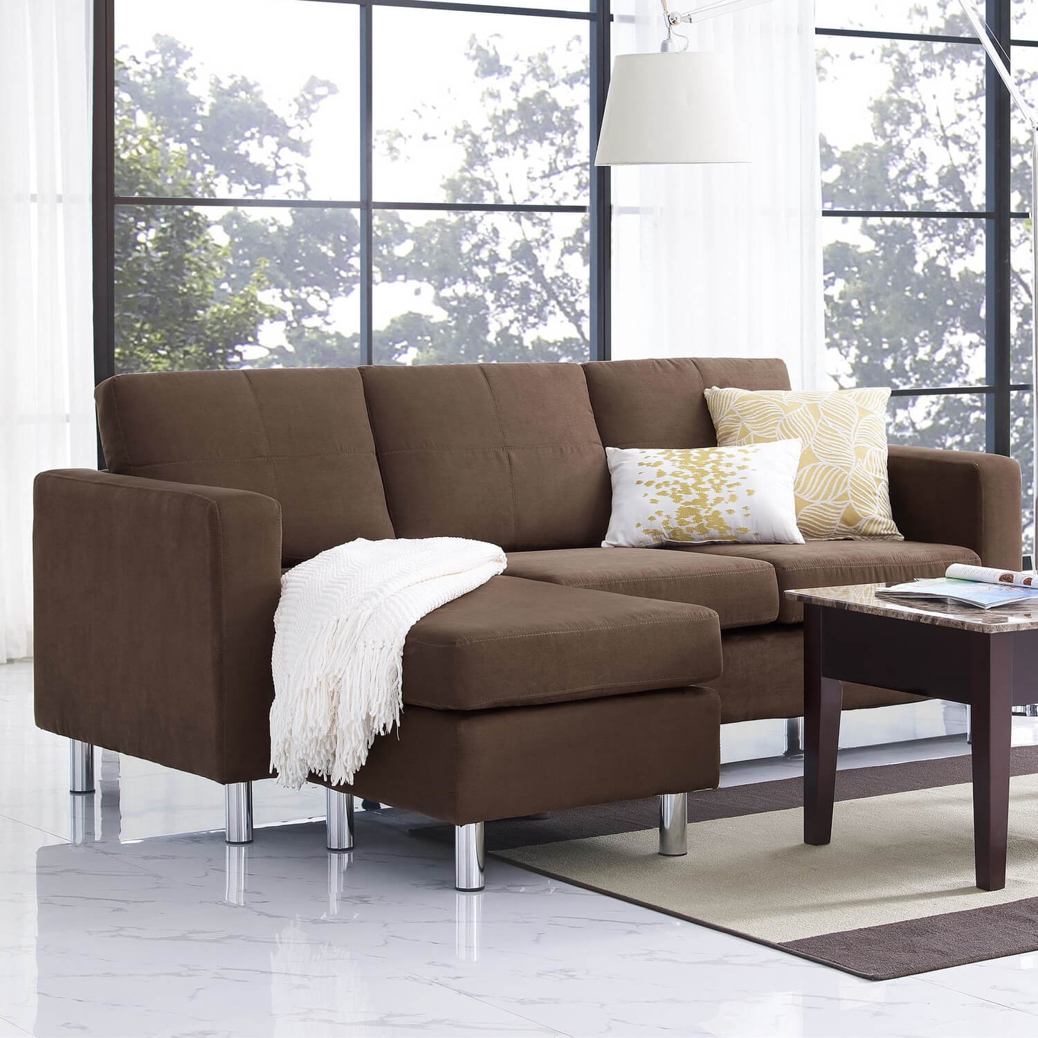 Here we see the same couch in a rich brown microfiber upholstery. The sofas also give you the choice of clean track arm design (shown) or a rolled arm design.