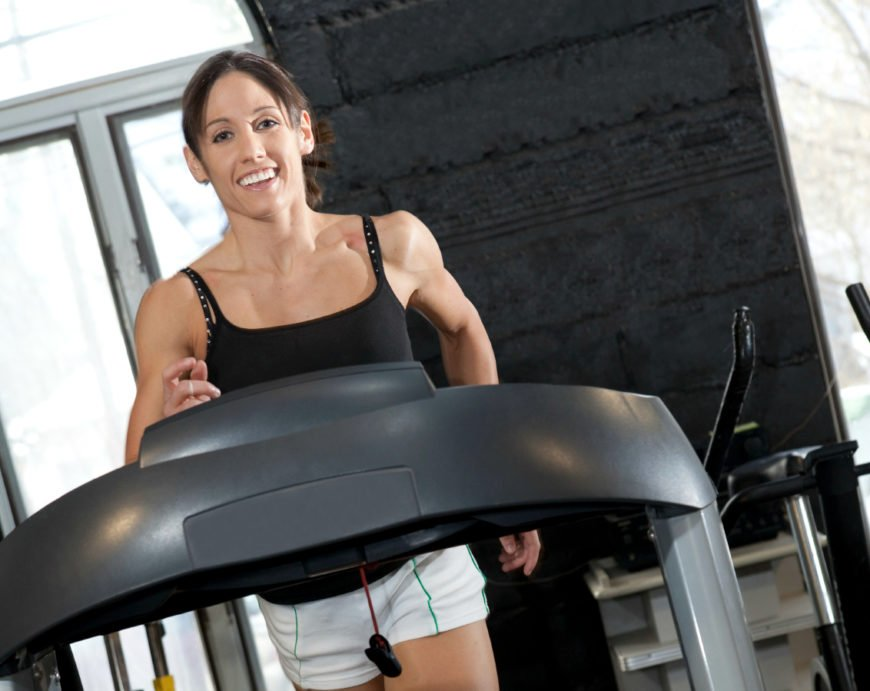 Woman running on a treadmill costing less than $1,000-Featured Image