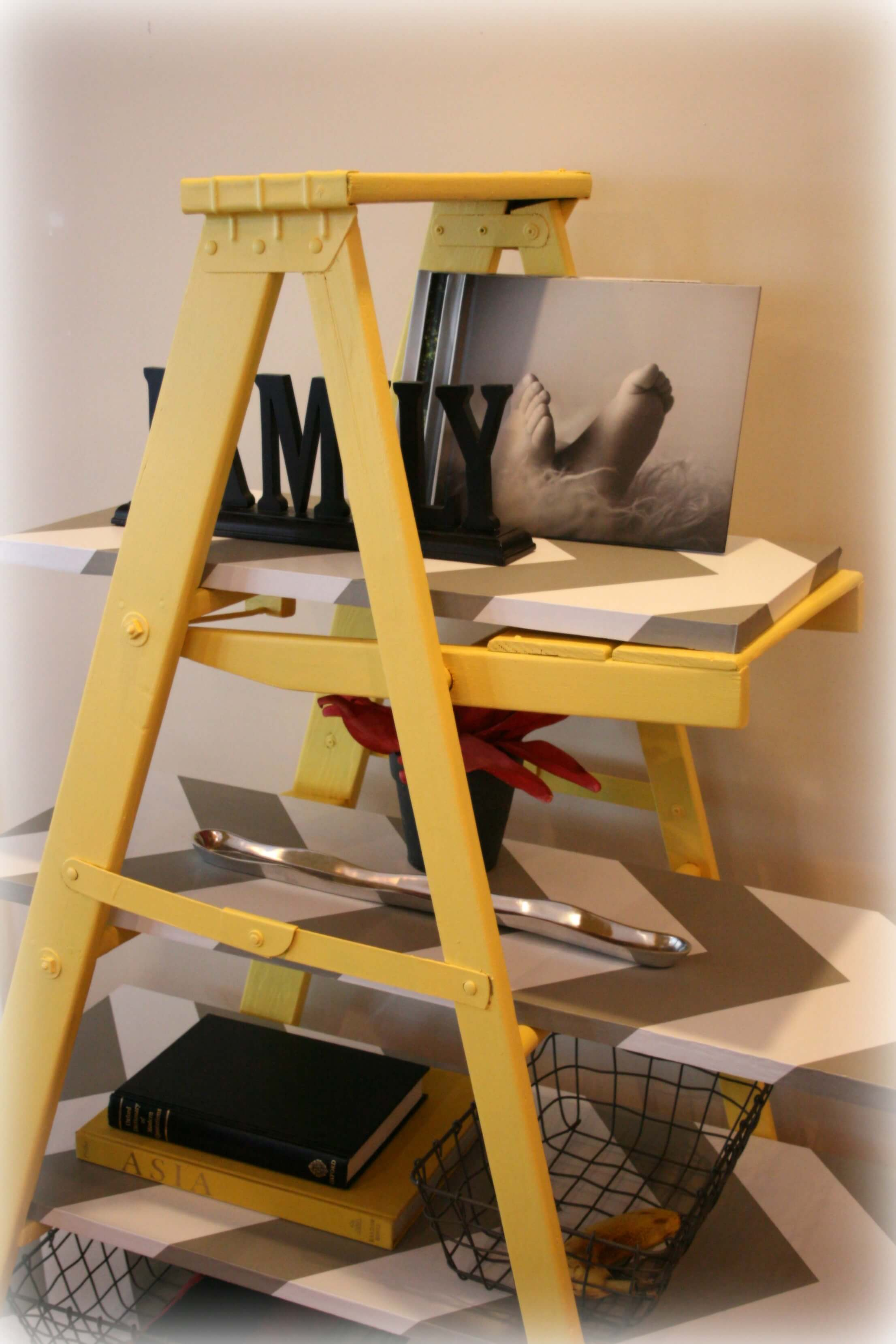 Top-down view of Heidi Marsh's leaning book shelf ladder in yellow