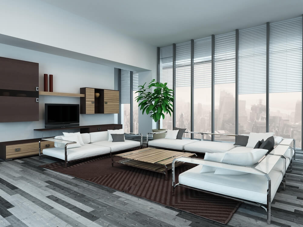 Ultra modern living room features metal framed sectional with white cushions and glass shelving over grey wood flooring, centered around innovative wood and metal coffee table.