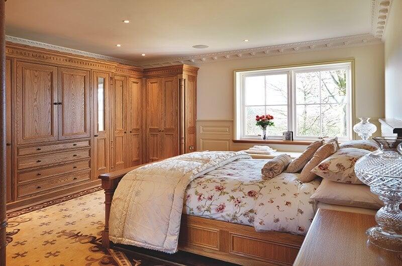 Primary bedroom with impressive wood work