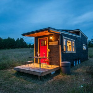 Tiny house on wheels with deck and loft bedroom - The Greenmoxie