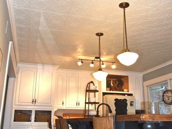 white kitchen with styrofoam ceiling tiles