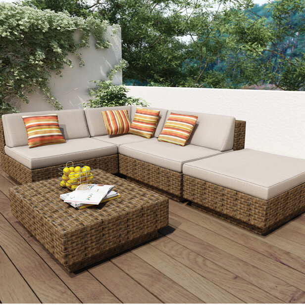 L-shaped patio sectional features large ottoman segment, with low-slung backs, and a large matching coffee table section.