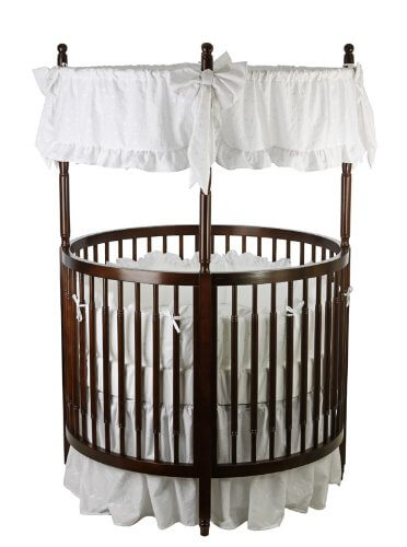 Circular design on this crib from Dream On Me allows for high visibility for parents. Fixed-side construction ensures stability, while four position mattress support allows for variation in placement. Dark hard wood with white linen canopy completes the classic design.