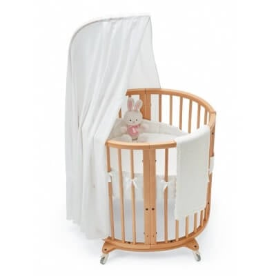 The Sleepi Mini bundle from Stokke can be ordered in a variety of finishes. The original narrow form is perfect for newborns and small infants, while the reconfigurable shape allows additional parts to turn this into a longer, oval shape as the child grows. One removable side for when child is old enough to climb in and out.