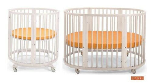 This fully convertible crib, courtesy of Stokke, begins as fully round structure with included mattress. Conversion kit included transforms into oval shaped crib for growing children, and includes appropriate mattress for the new shape. Locking cater wheels and adjustable mattress support reinforce transformative aspect.