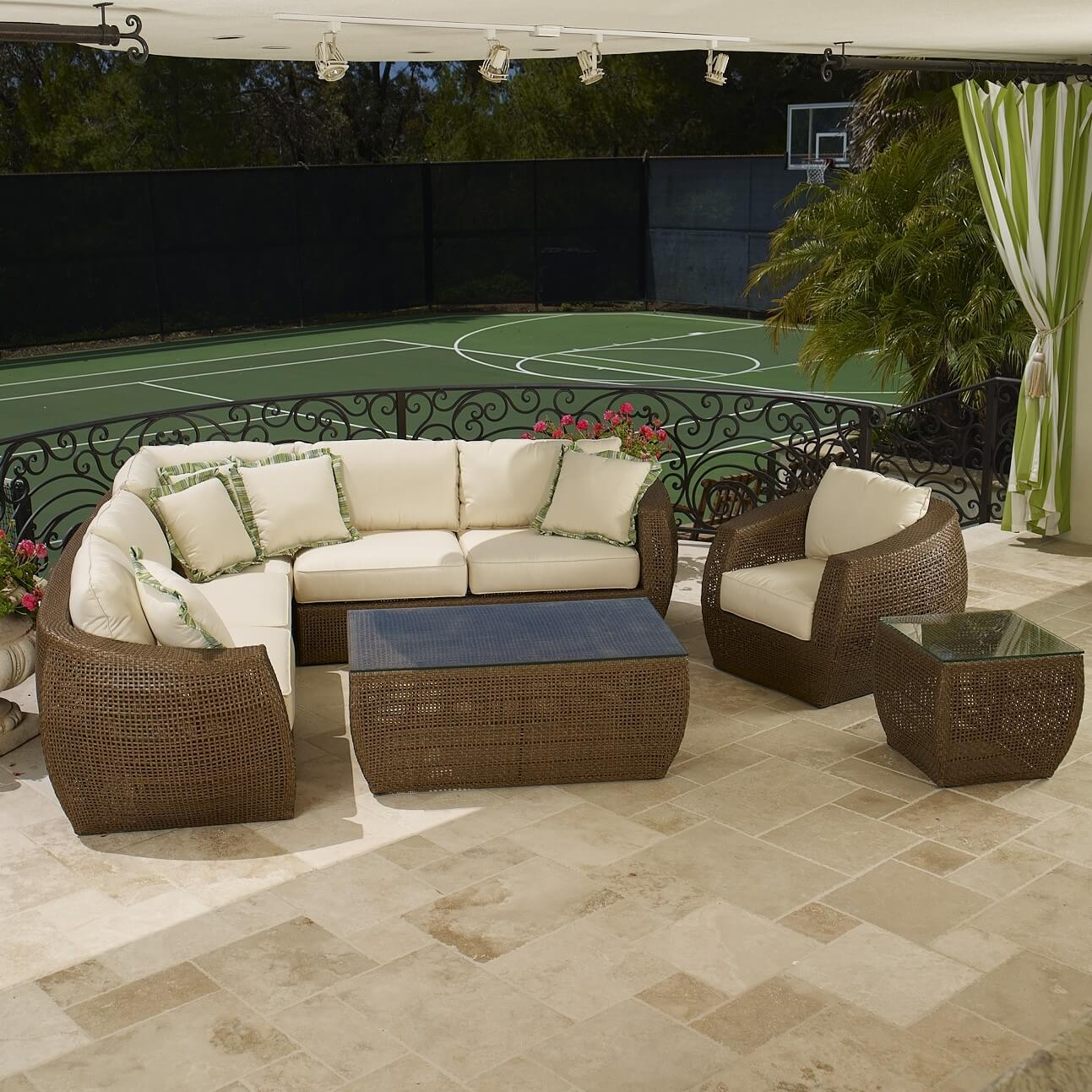 This wheat-toned deep seating sectional wraps thick white cushioning in a rounded body, with L-shaped main body and separate armchair for multiple seating options. Includes glass topped coffee and side tables.