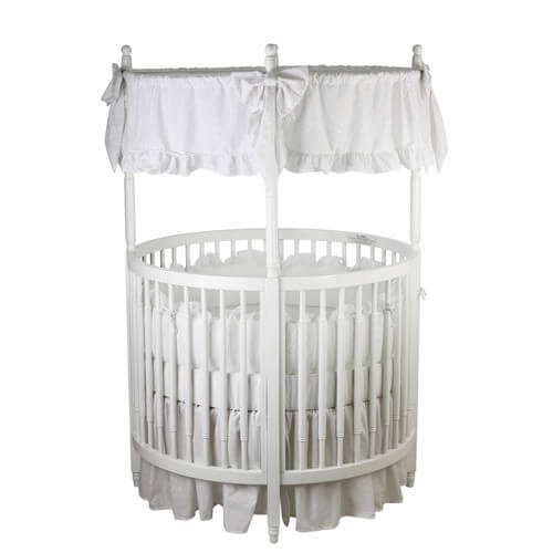 The Dream On me posh circular crib comes in all white solid wood construction, with round design for enhanced visibility. Non-drop side rail for safety. Mattress can be height adjusted for growing baby needs.