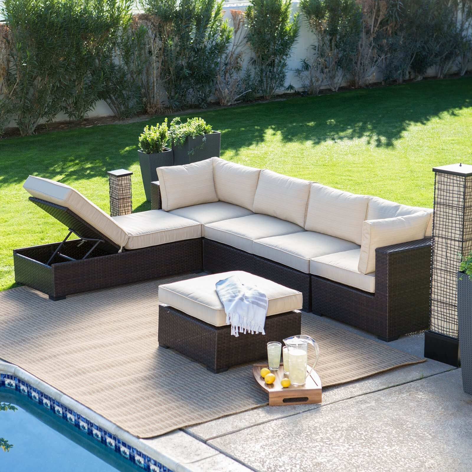 Lengthy patio sectional features standard sofa shape, plus chaise lounge section with movable backrest, and ottoman section for variety of configurations.