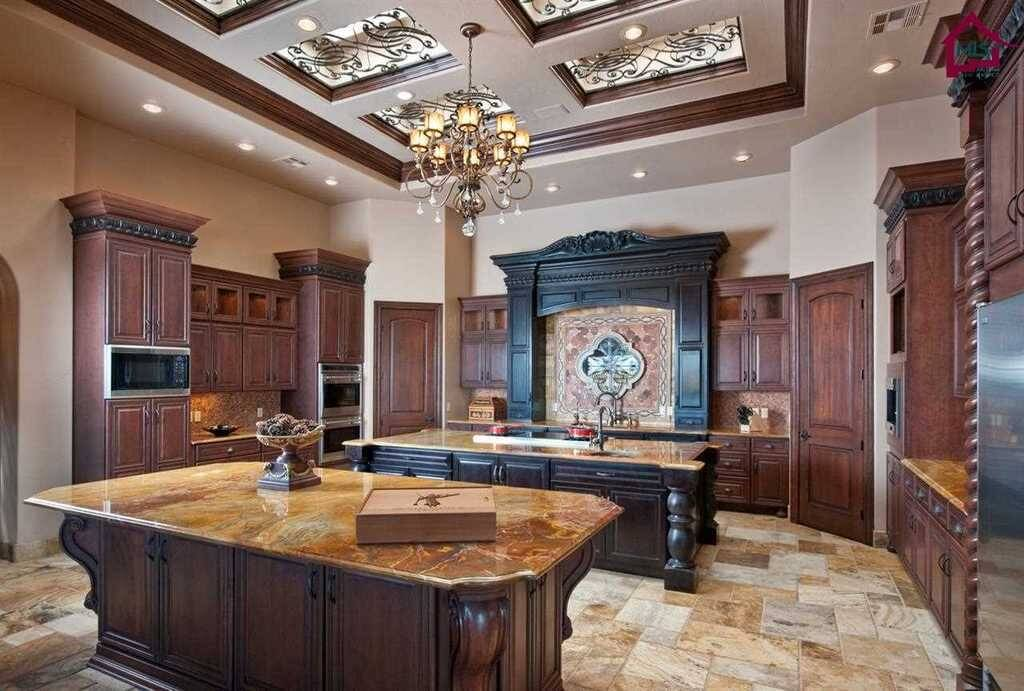 Two tones of wood used throughout this custom kitchen. The cabinets and islands are built with stunning craftsmanship.