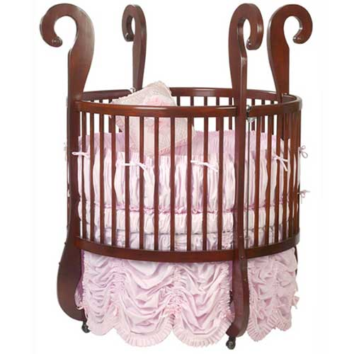 The Liberty Sleigh crib comes crafted in North American hardwoods in a variety of finishes. Ruffled skirt and bedding in pink is perfect for baby, while curved hook style four posts add functionality and beauty. Adjustable mattress height can grow along with baby.