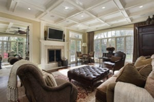 This elegant room includes the table and large comfortable couches for lounging and watching television. This living room is gorgeous with the dark wood and dark leather couches contrasting the light colored fabric couches.
