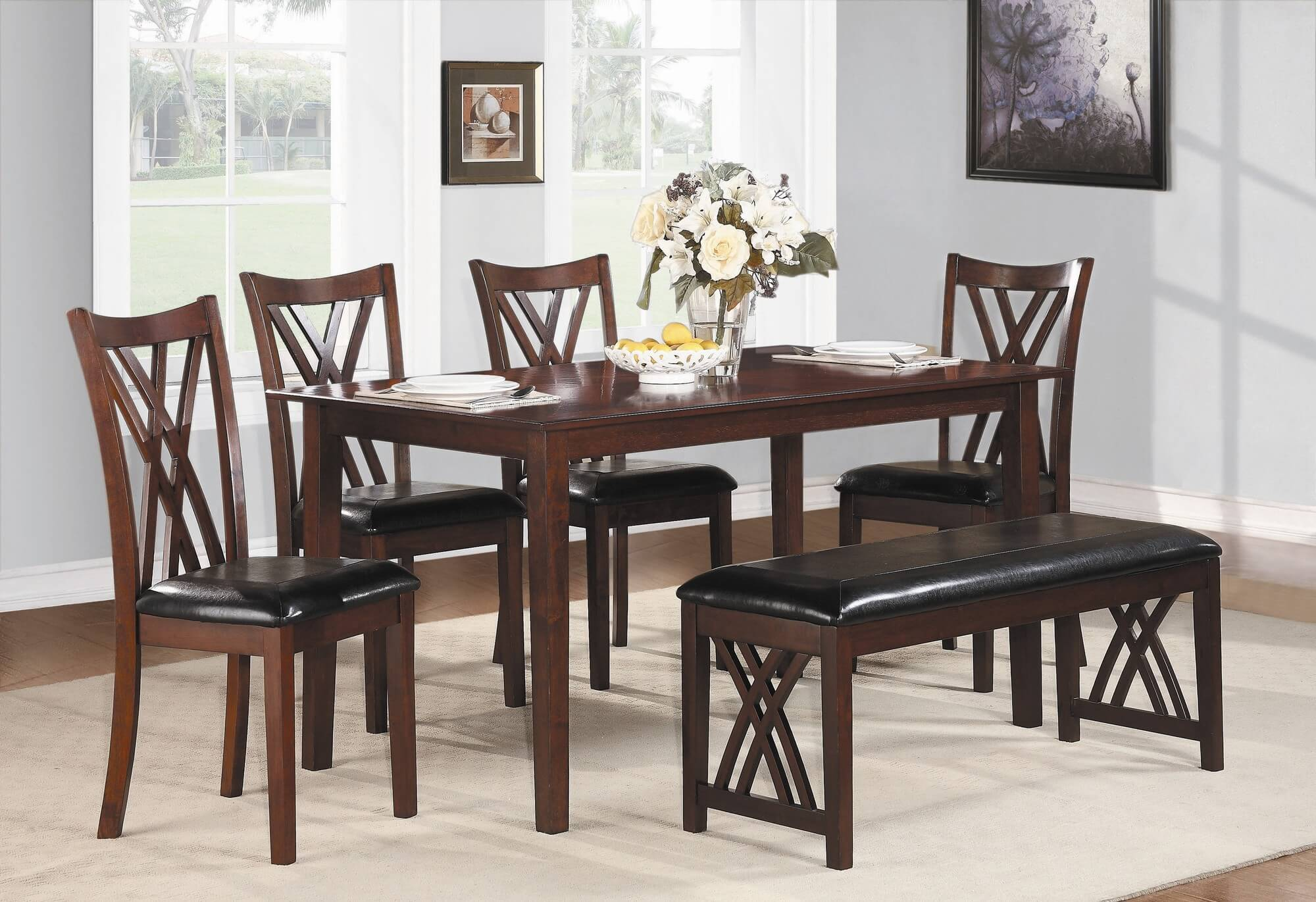 Six piece dining set with bench with a cherry finish and upholstered chairs and bench.