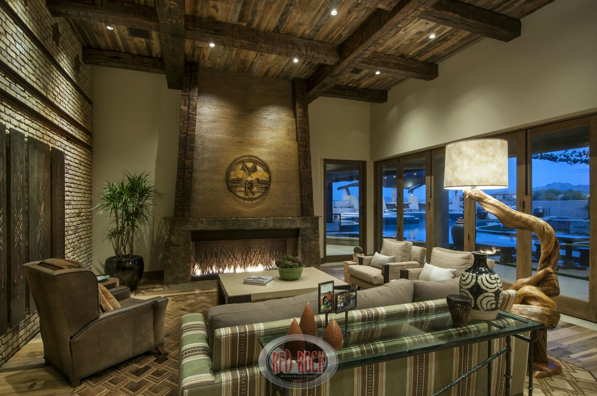 Like the living room above, the family room has an elevated, wood beamed ceiling.