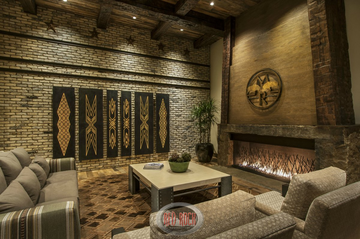 This view of the family room showcases the fabulous brick wall and wide fireplace.