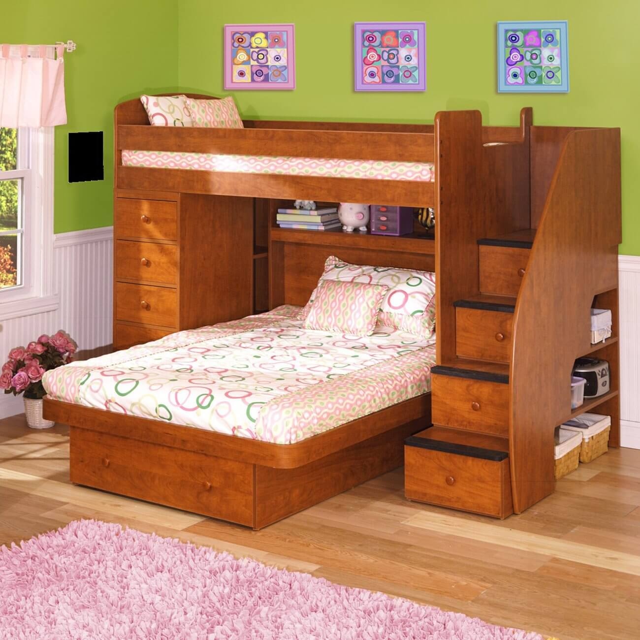 This engineered wood L-shaped bunk is a twin over full size bed. The lower bed is not on wheels. You have the choice of finishes (including white).