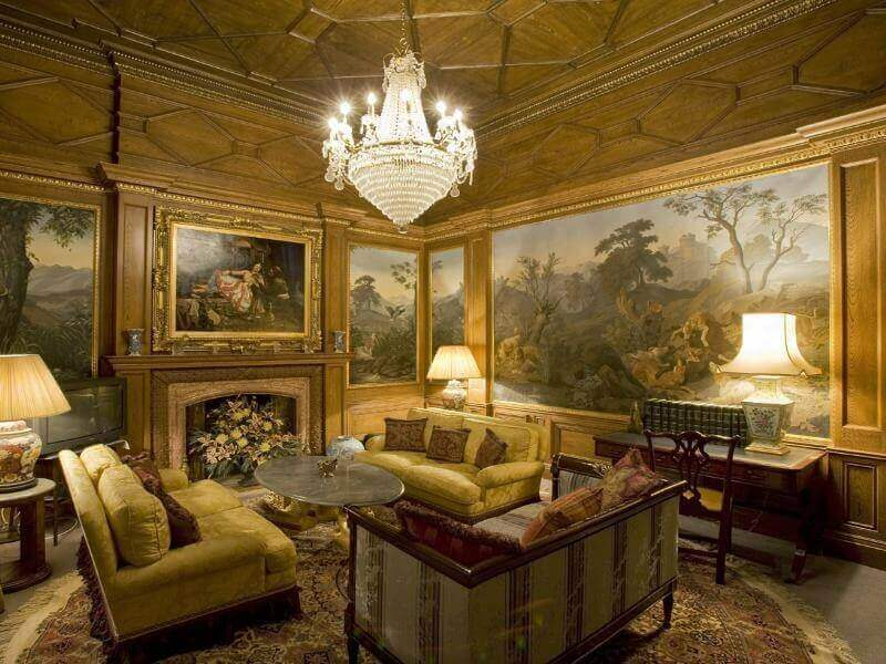 Here's another ultra lush living room, with detailed wood textures on gold walls and ceiling, with beautiful classical paintings covering wall surfaces.