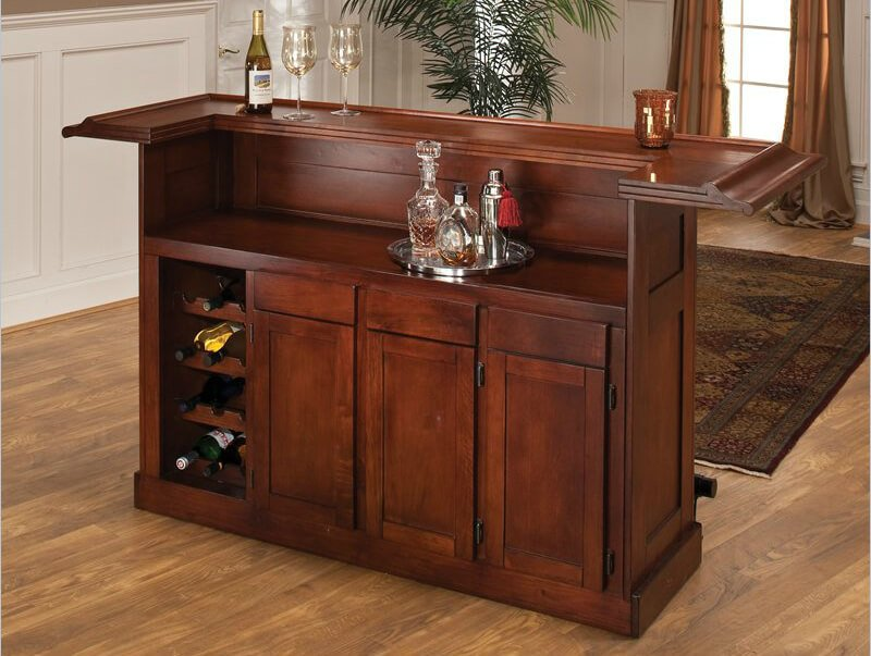 This mini-bar a behind-the-bar preparation counter as well as elevated counter bar. Moreover, the top wraps around slightly.