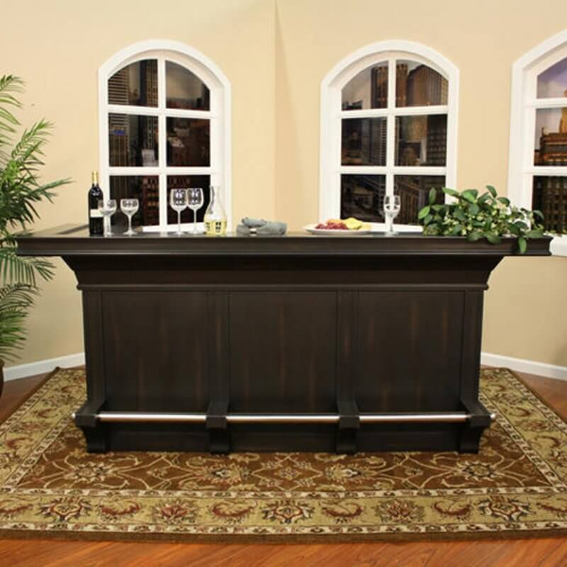 This dark brown home bar cabinet is larger than most assembly style units. Built with hardwood, it's a sturdy unit that includes a foot-rest bar on the bottom making it a terrific unit for placing bar stools along the front.