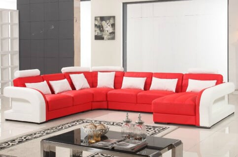 This is a very modern sectional sofa design with bright red and white color design. Each side of the sofa includes arms and some sections of the sofa includes a headrest.