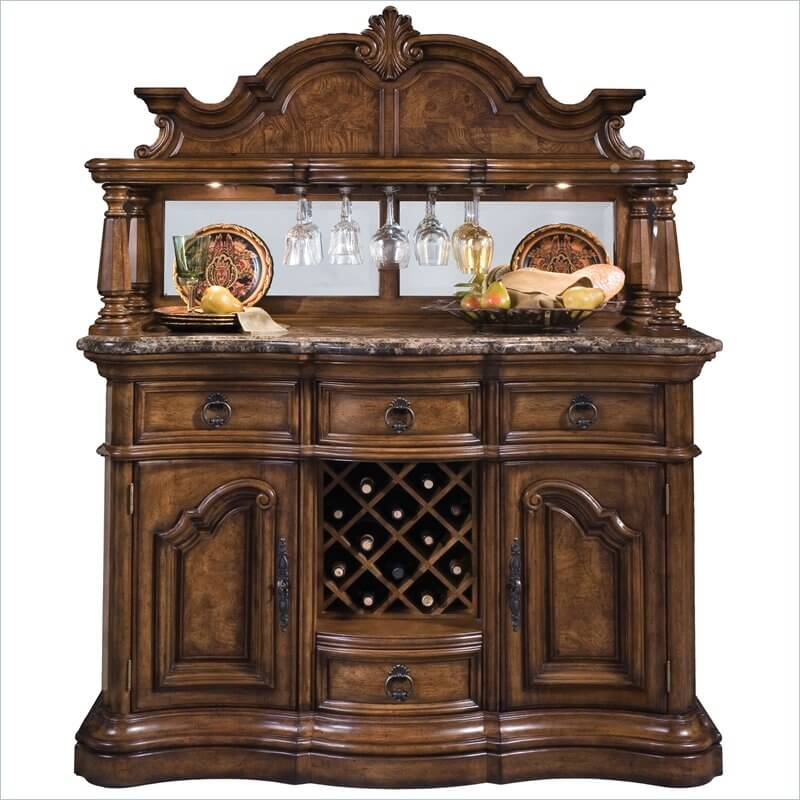 This home bar includes a wine rack in the center flanked by closed cupboards and drawers. The top row is a series of 3 small drawers, ideal for silverware and small bar accessories.