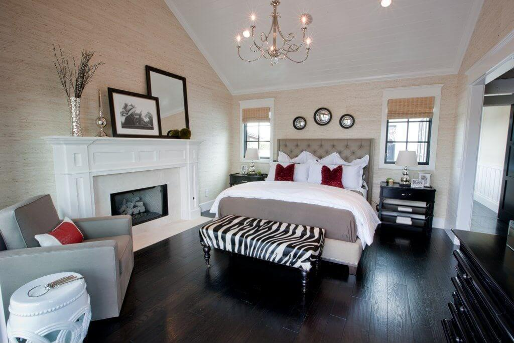 Here's a terrific contemporary bedroom décor in which the zebra print ottoman works beautifully at the foot of the bed. The color scheme is neutral with white, greys and dark wood... the zebra print ties it all together. In fact, the ottoman brings the room to life.