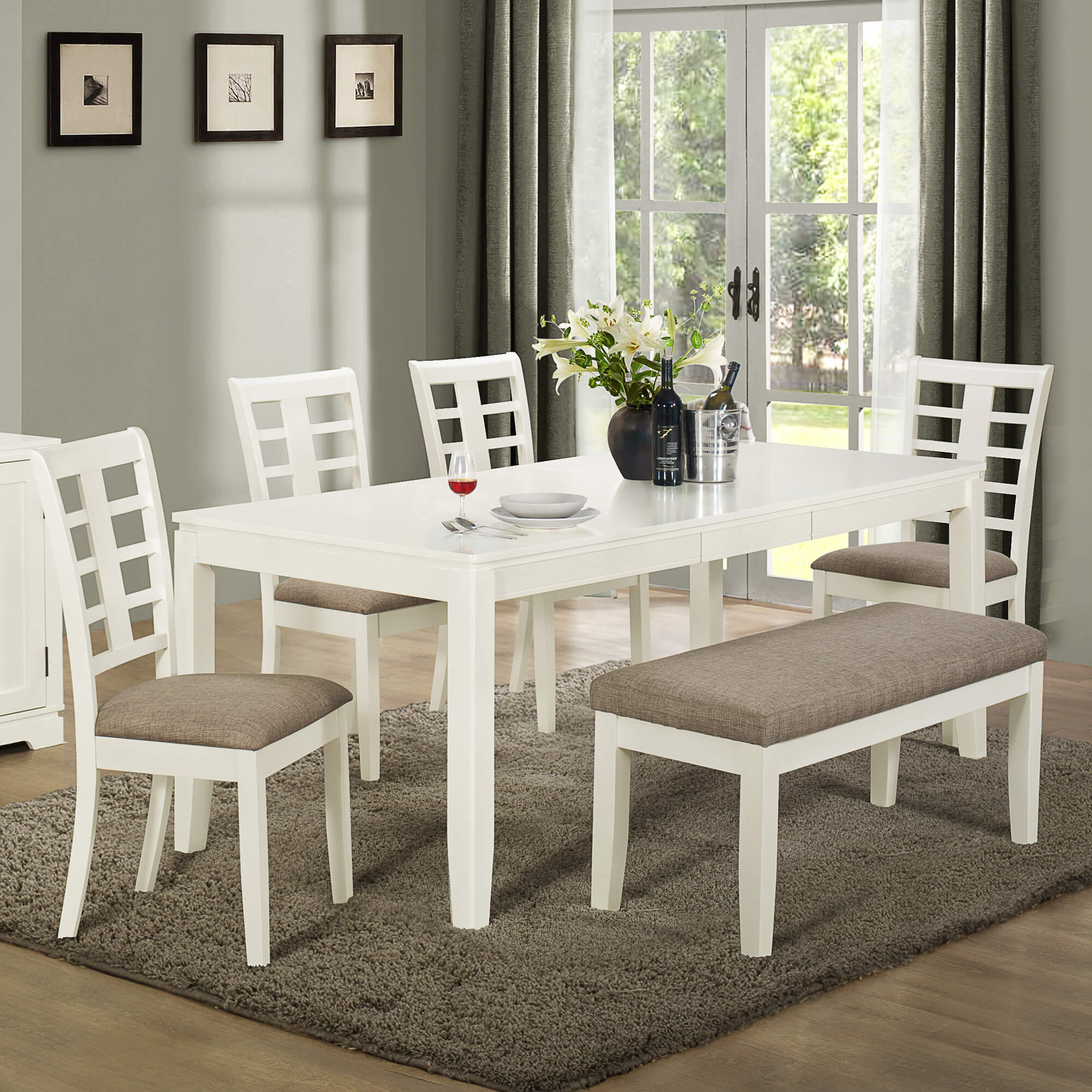 Built with solid wood and MDF board, this white and grey dining set with bench lightens up the dining space. As you can see it, works well with a grey centric dining room, but also works in a light and white rooms.