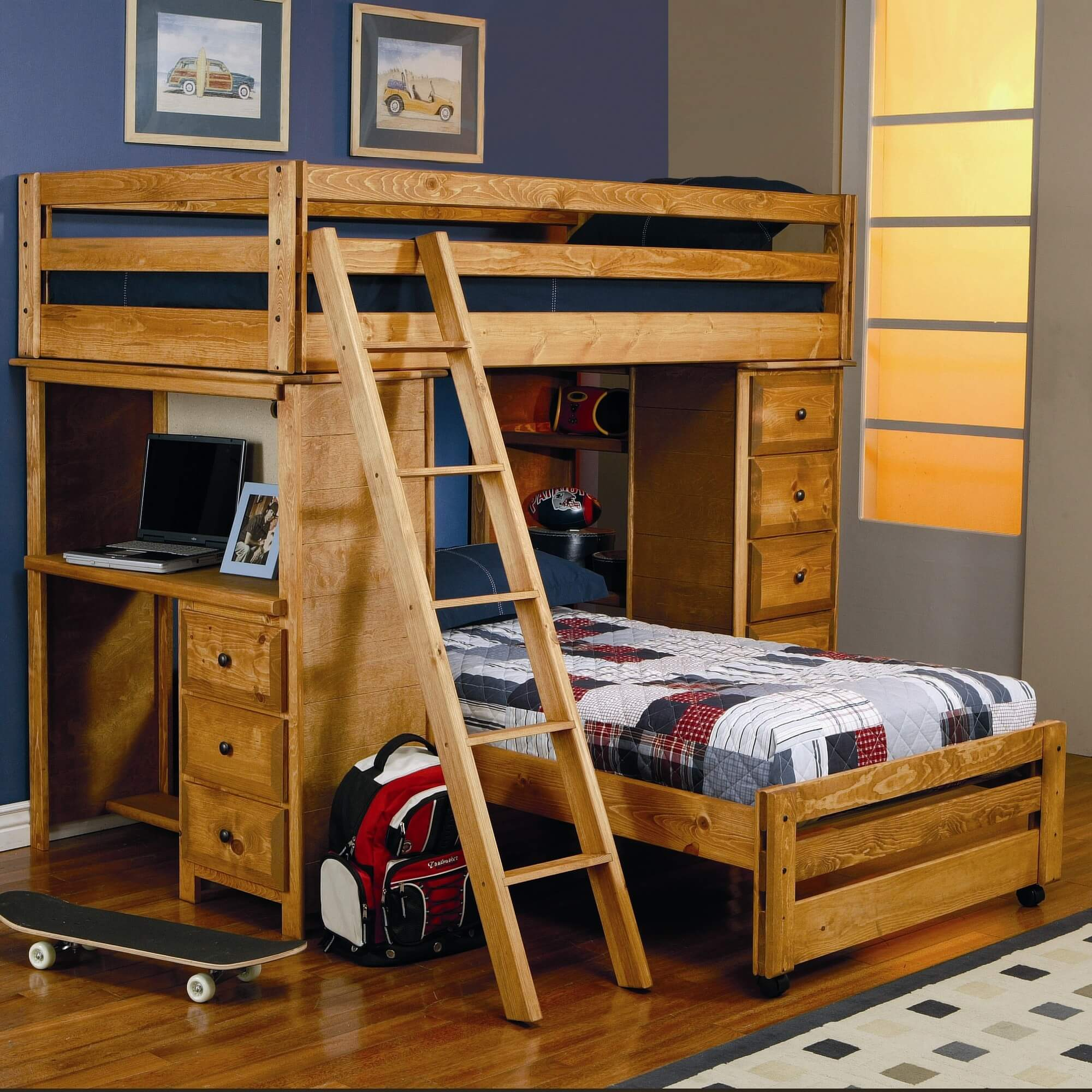 This solid pine L-shaped bunk with a honey finish is a twin over twin. The bottom twin is one wheels. One side includes a desk with drawers and the other side drawers and open shelving.