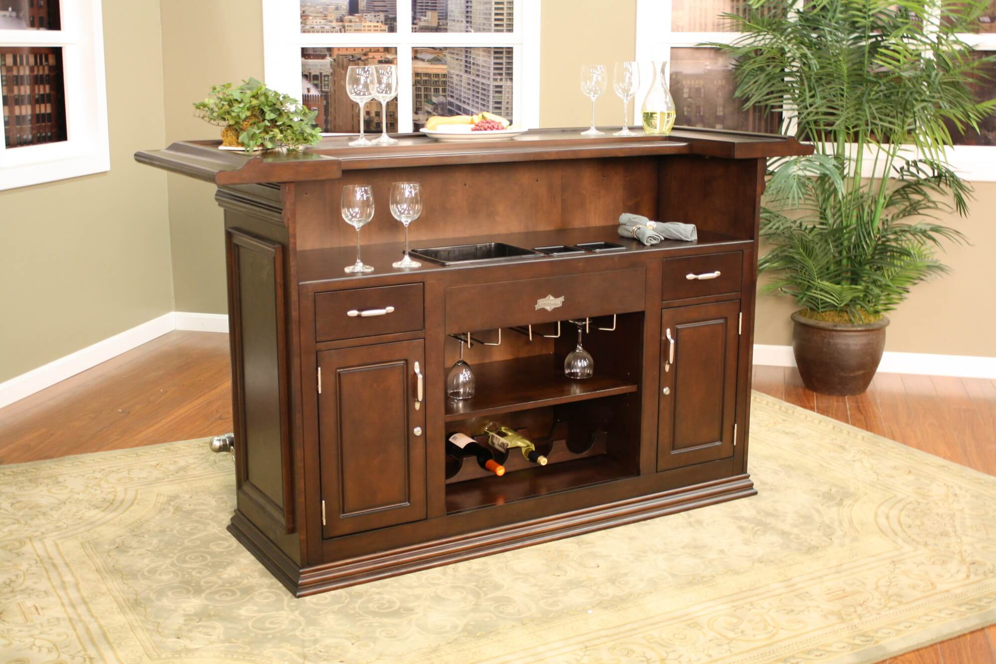 Back end view - For a smaller design, this home bar offers some great features such as a foot railing and a behind-the-bar preparation counter with built-in ice bucket and small wine rack.