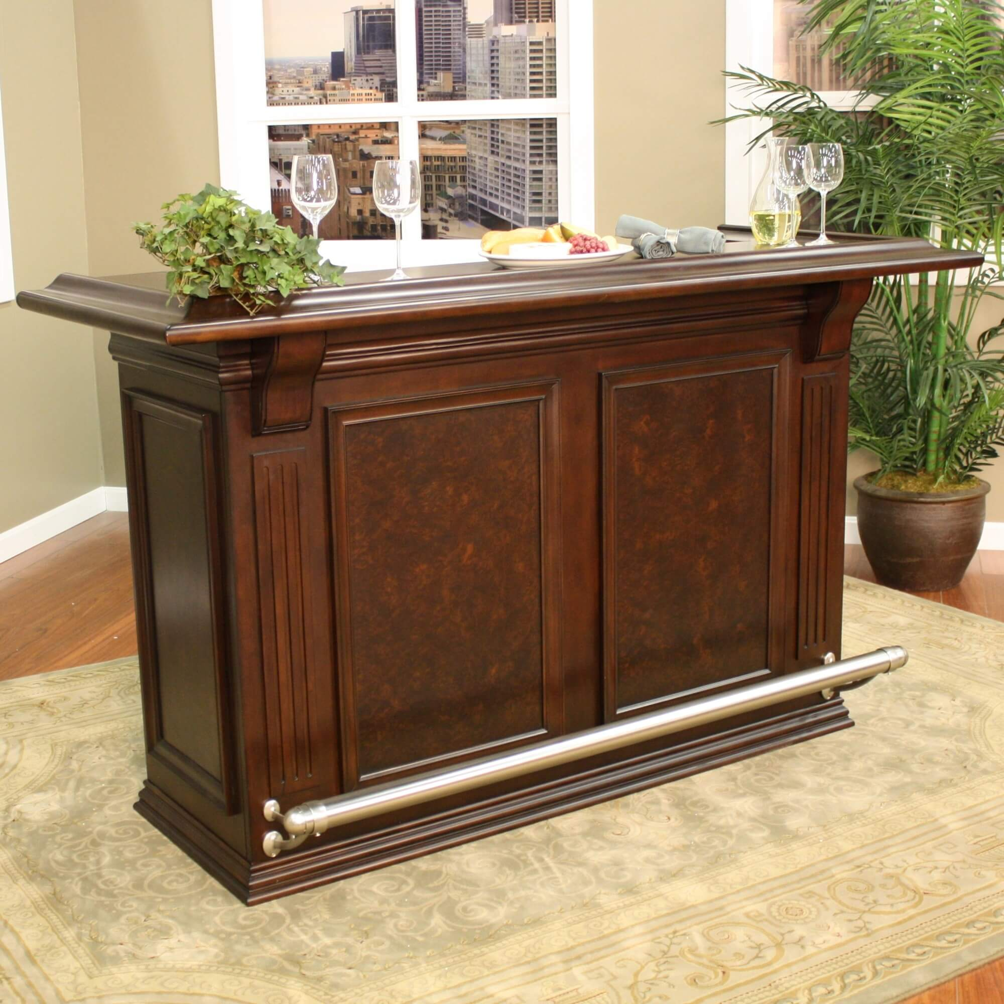 For a smaller design, this home bar offers some great features such as a foot railing and a behind-the-bar preparation counter with built-in ice bucket and small wine rack.