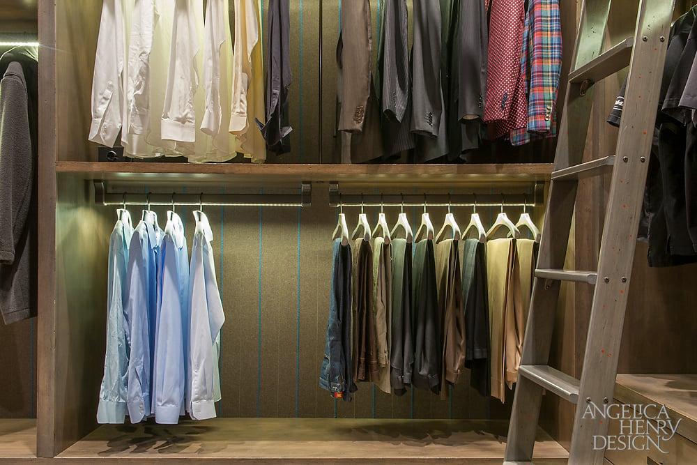 Close up of the suit rack in the men's luxury walk-in-closet.
