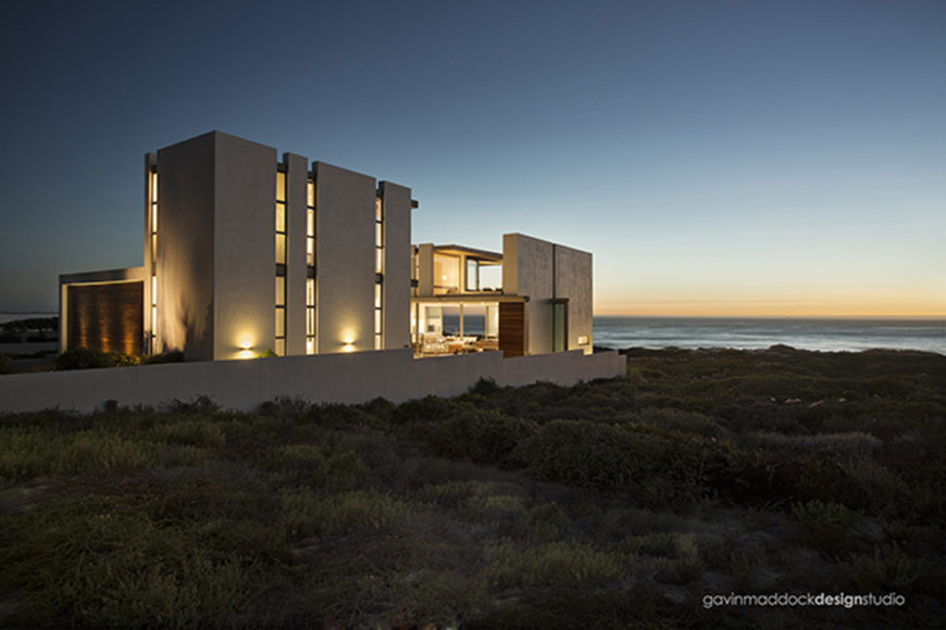 The entire home, lit up at night. Interior and exterior spaces blend perfectly.
