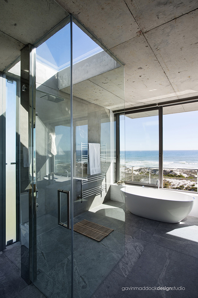 Here we see the strikingly original glass shower, with singular skylight above. This helps the illusion of bathing right on the waterfront in the open air.
