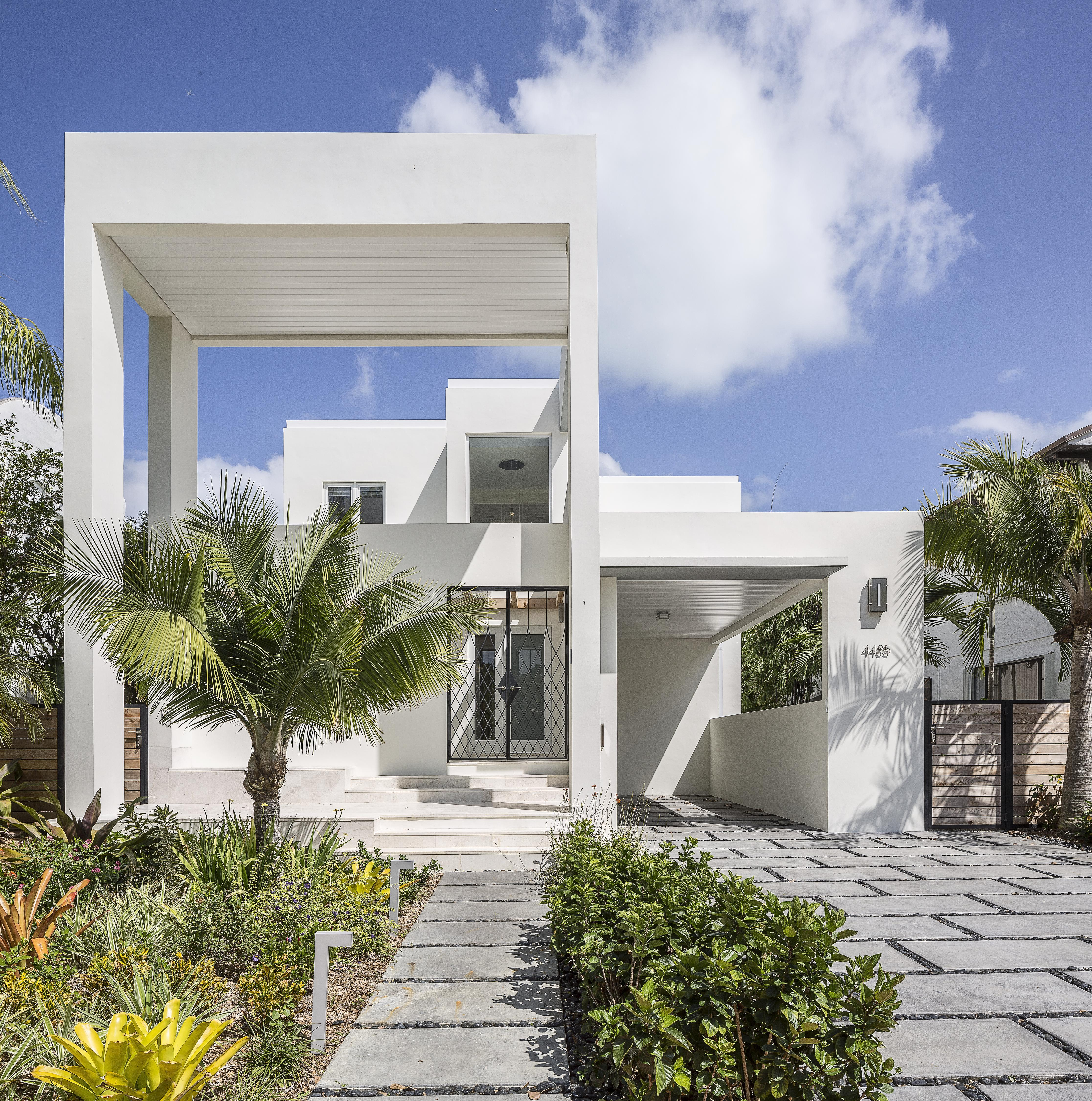 Royal Palm White Modern Home by NC-Office Architects.