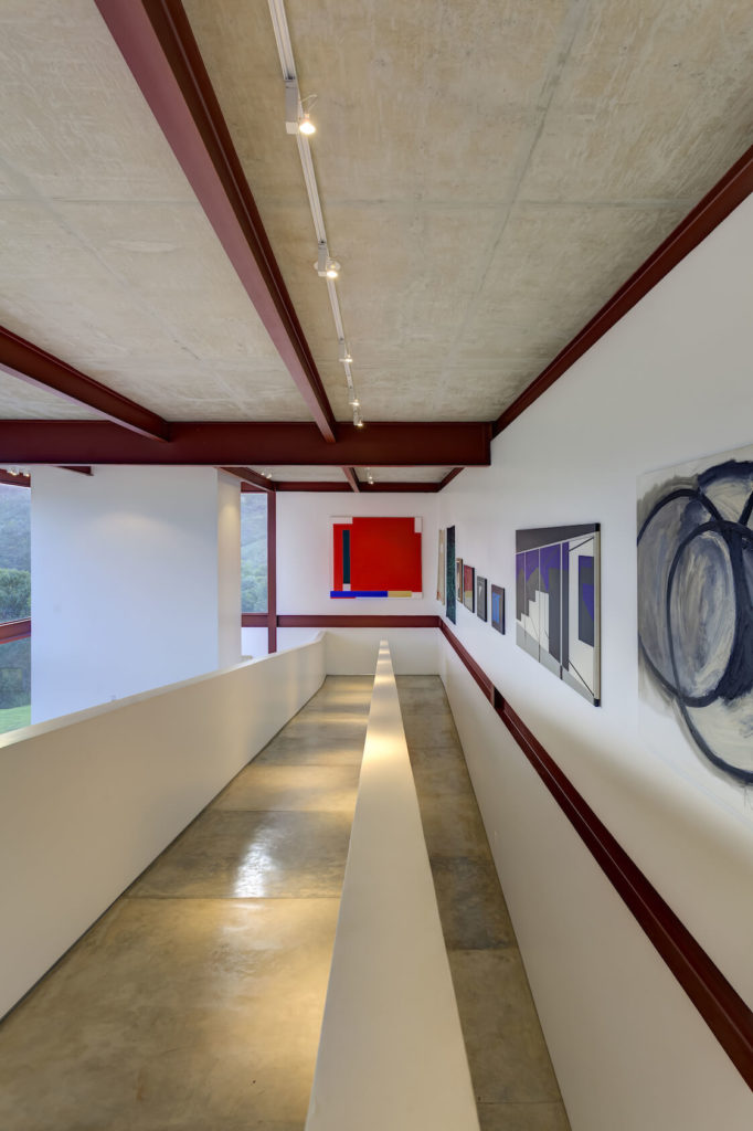 Looking down the immense ramp, we see artwork adorning the entire wall.