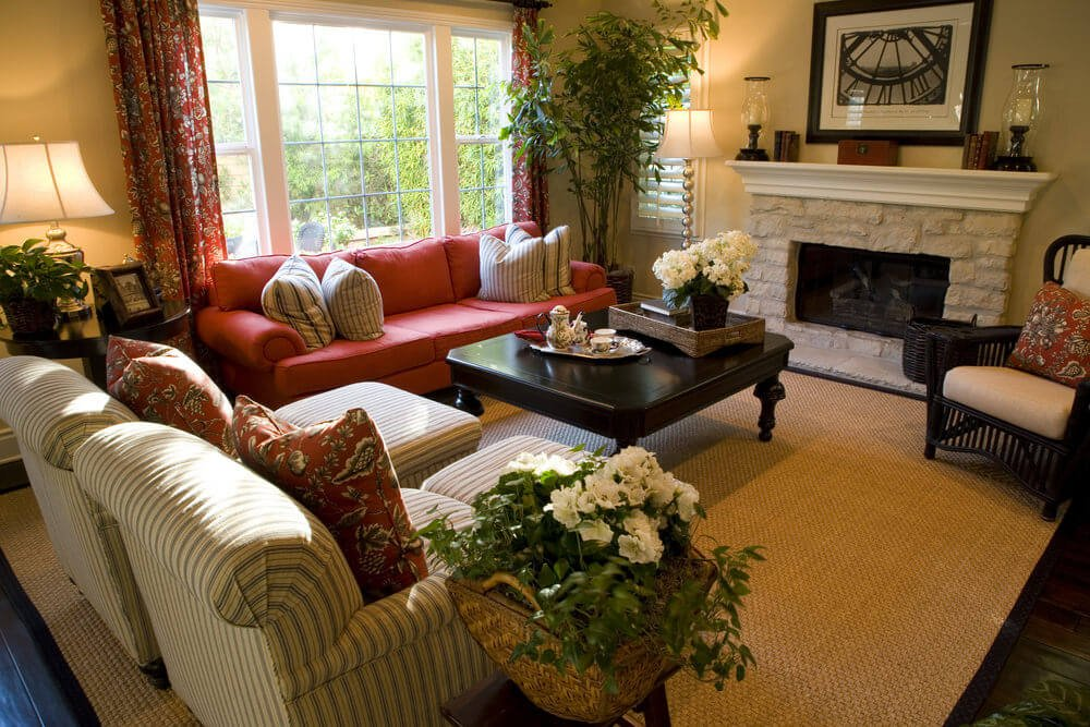 Terrific color scheme makes up this fabulous living room design. I like the different colored furniture. The red sofa really works with the earth tones.