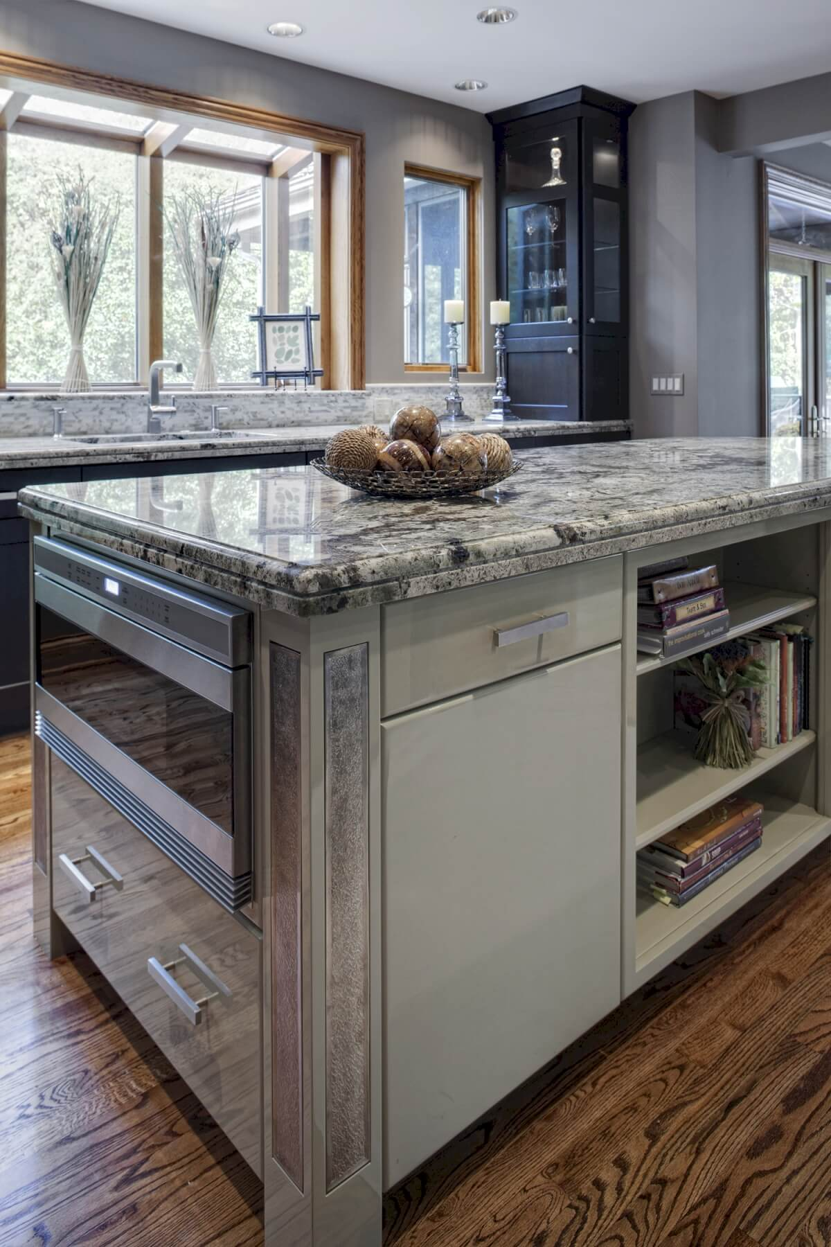 The island features pewter accent strips on the corners, over its high-gloss soft green finish.