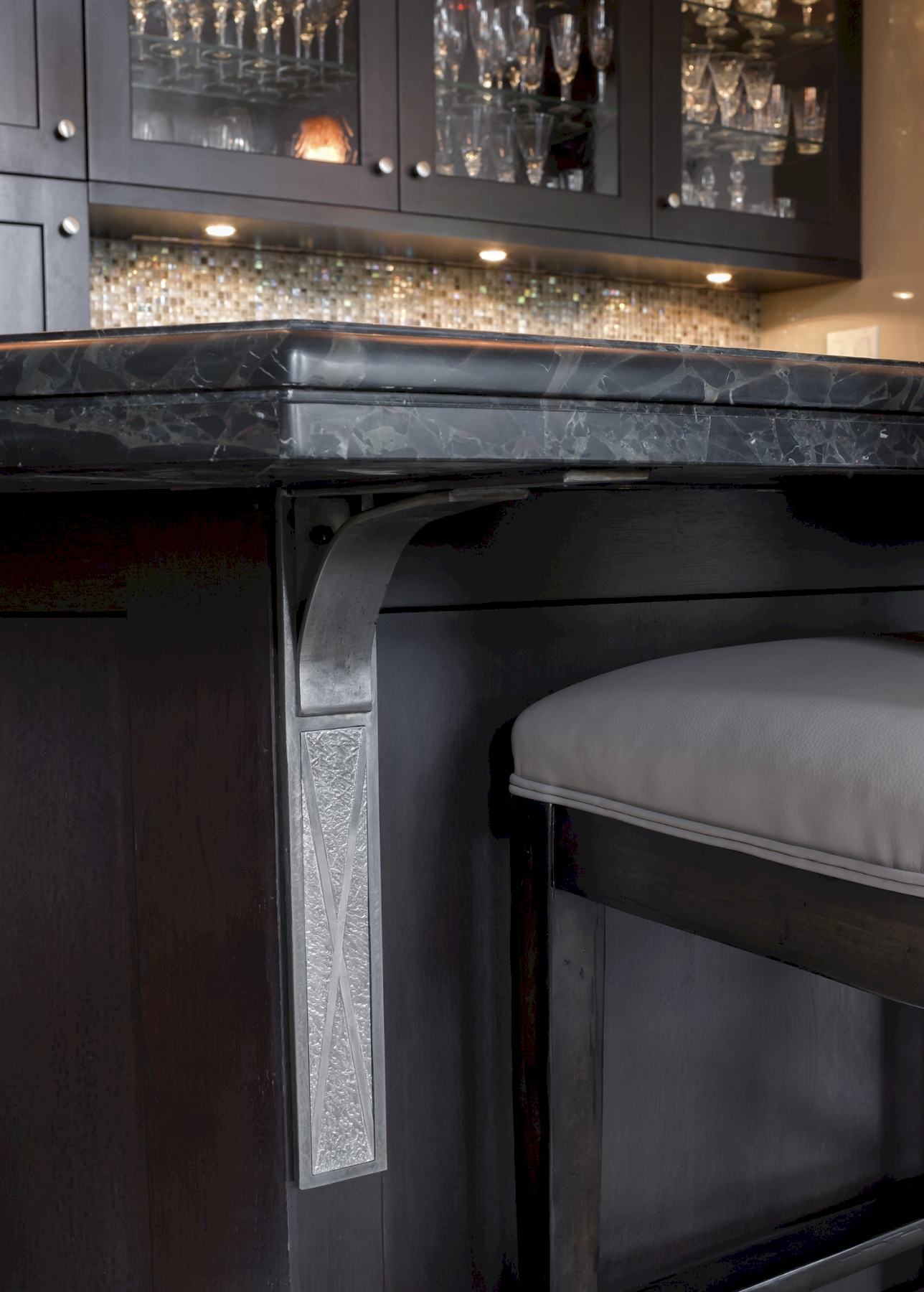 Espresso finish on the island is complimented by the pewter corbels.