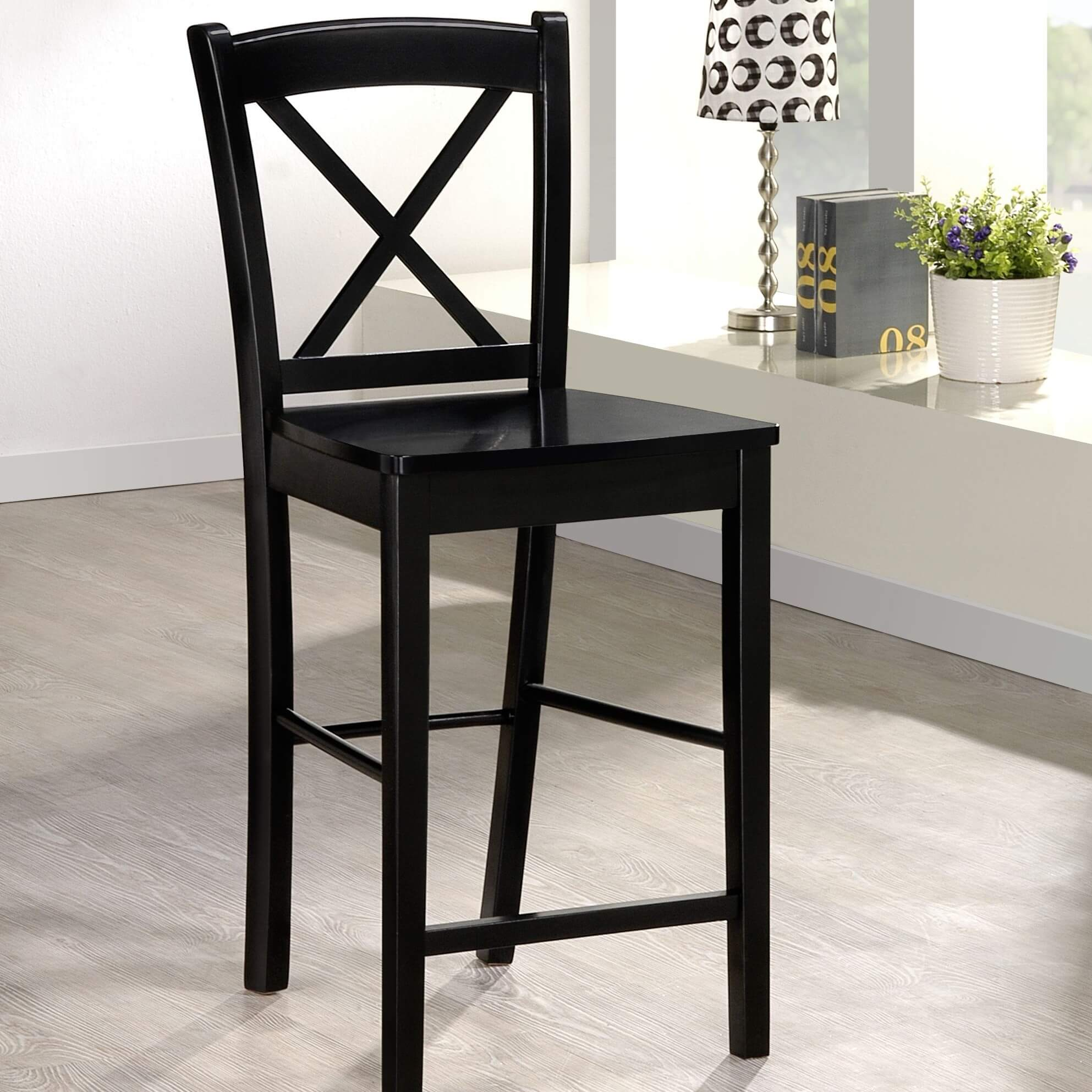 4-legged stool with a cross back design and cushioned upholstered seat.