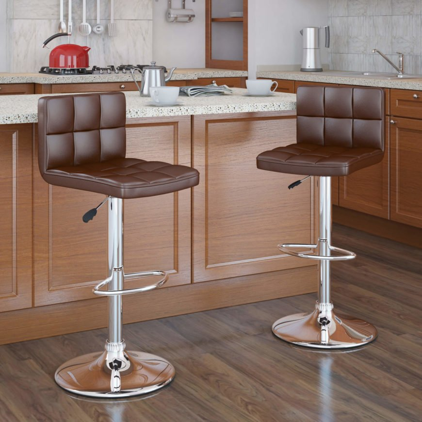 Pair of modern chrome frame adjustable height stools with brown seats.