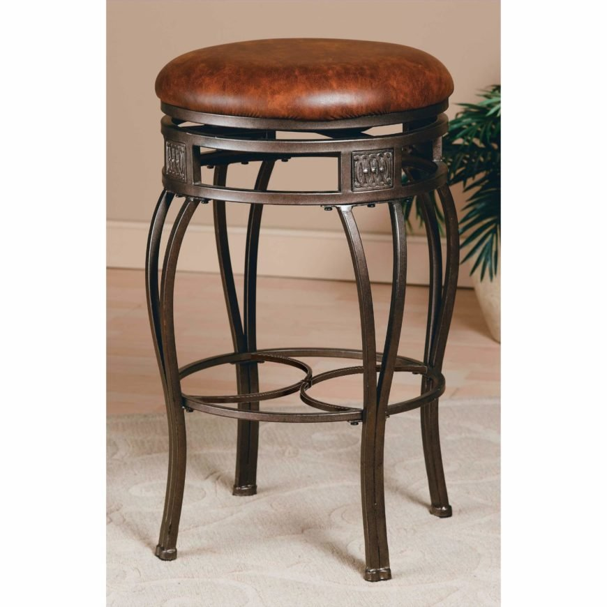 Traditional backless stool with ornate legs and upholstered round seat.
