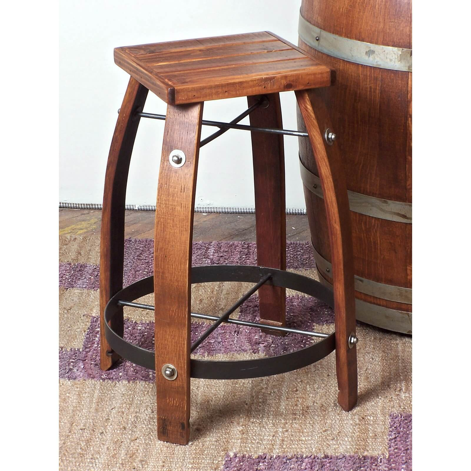 Wood stool designed in the barrel style with square seat.