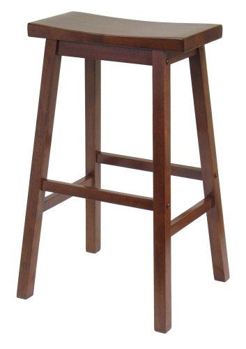 Walnut saddle stool.