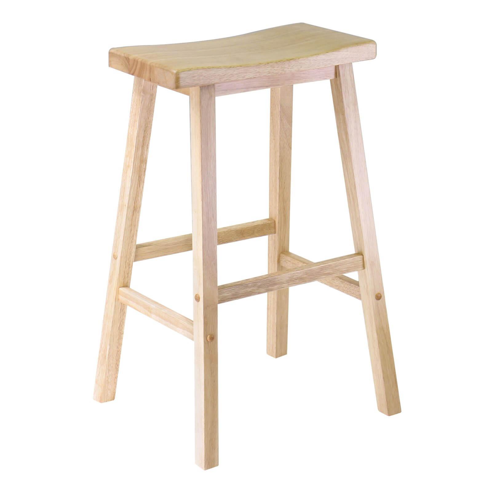 Pine wood backless saddle-style stool.