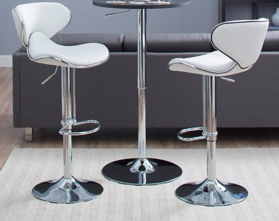 This elegant white modern stool offers a contoured bucket seat design sitting on a pedestal base. The stool adjusts up and down from 24 to 32 inches. The upholstery is white faux leather. This stool comes as a set of two.