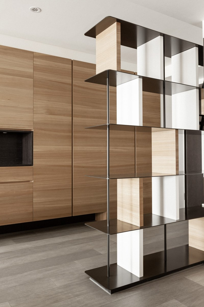 This intricate, modern shelving pairs natural wood and black metal for a spartan, open design.