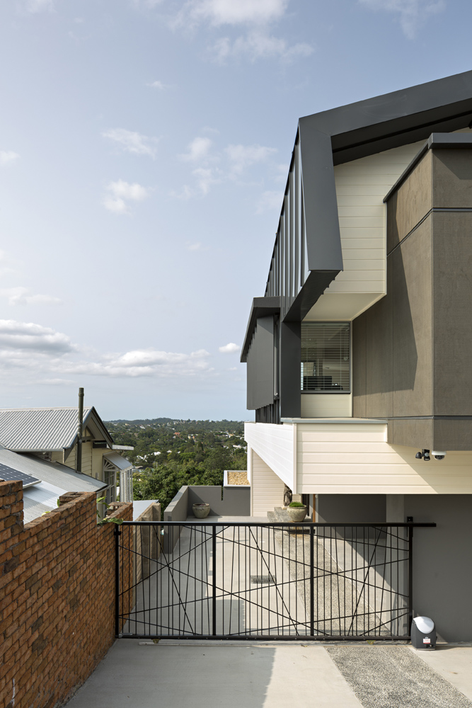 The home cascades down its sloped plot, with rooms on the side possessing individual views toward the valley below.